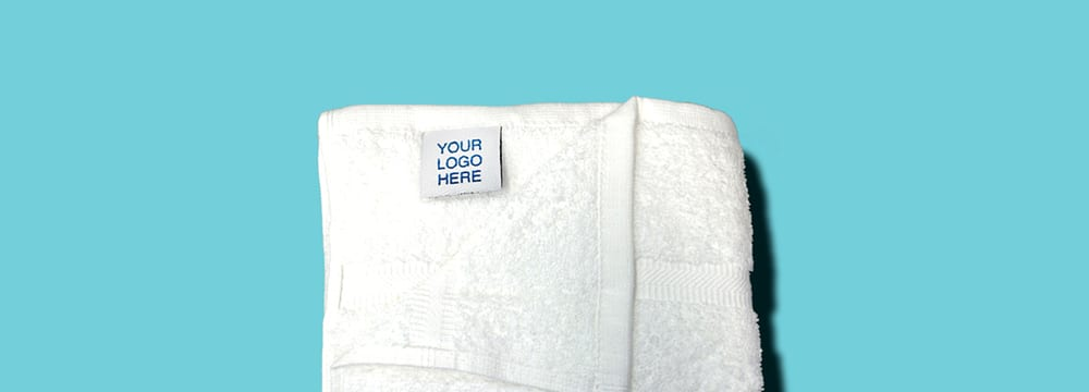 """White Towel with """"Your Logo Here"""" Tag"""