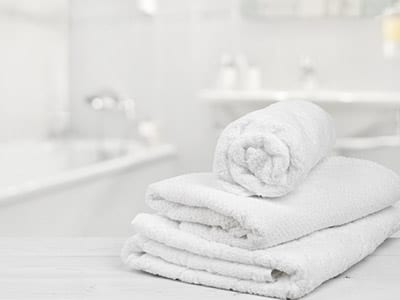 Stack of white towels in bathroom backdrop