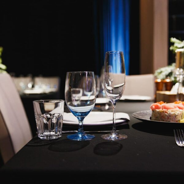 Wine glasses on black table linen