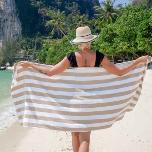 Beige Cabana Beach Towel around woman