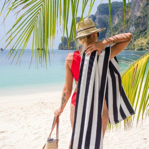 Black Cabana Beach Towel over woman's shoulder