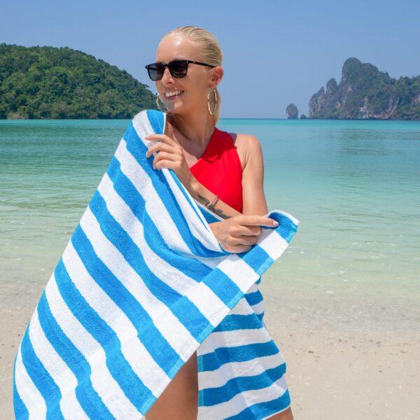 Blue Cabana Beach Towel wrapped around woman