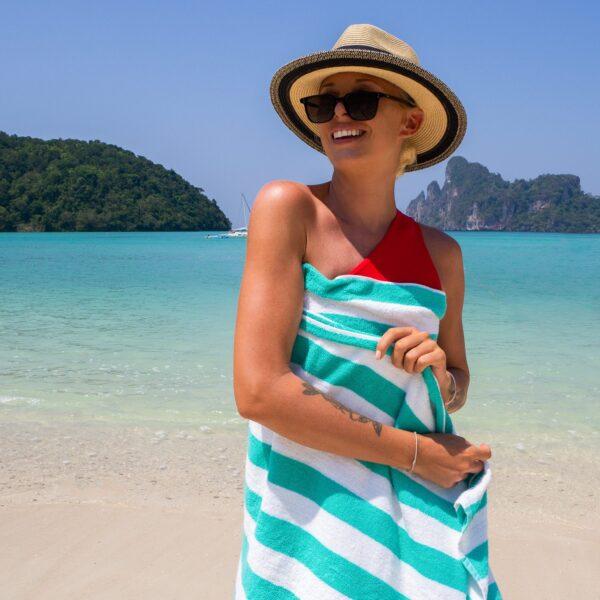 Green Cabana Beach Towel wrapped around woman