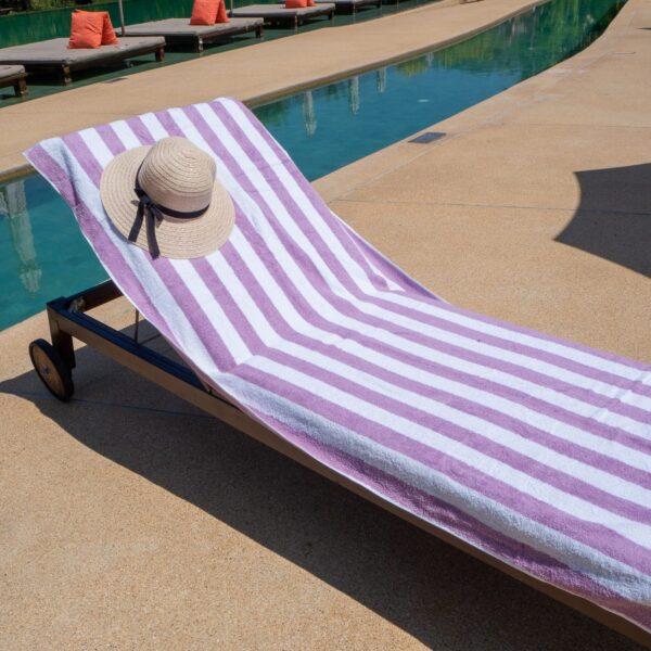 Purple Cabana Pool Towel on poolside chair