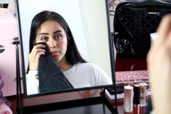 Woman wiping off makeup with Makeup Towel