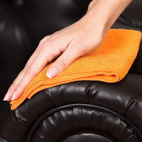 Orange Microfiber Cloth used to wipe down sofa