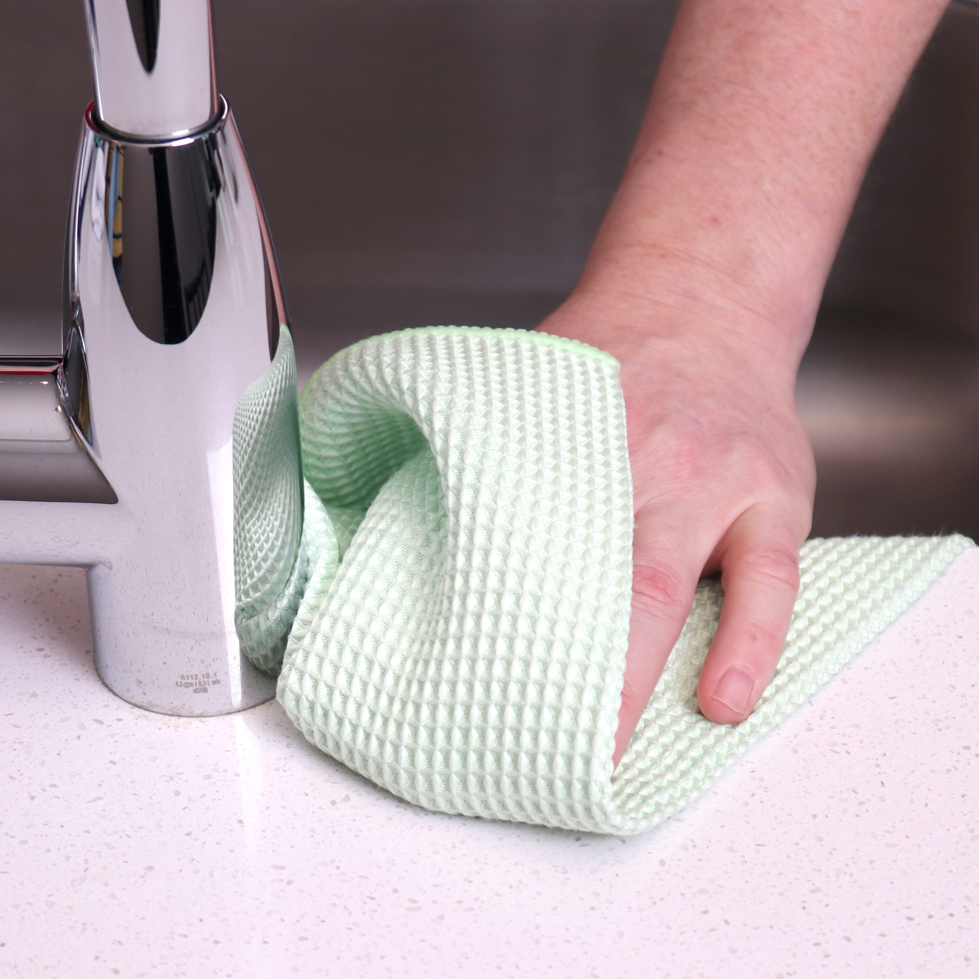 Green Waffle Microfiber Hand Towels used to clean counter