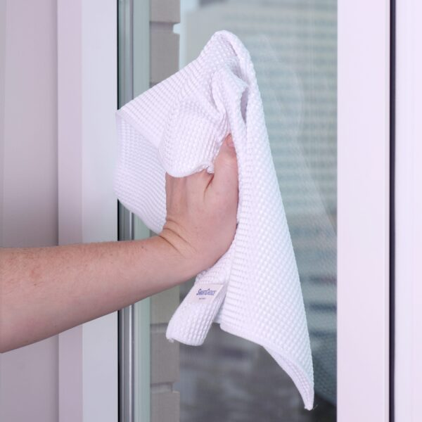 White Waffle Microfiber Hand Towels used to clean window
