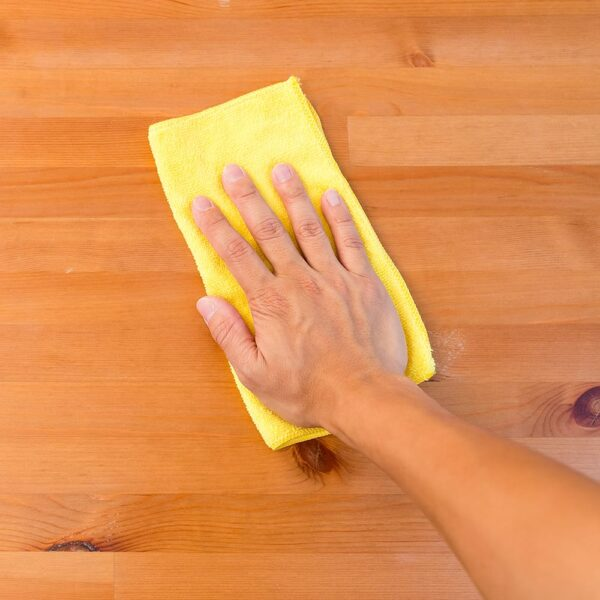 Yellow Microfiber Cloth used to wipe down table