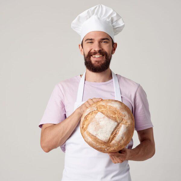 Baker wearing white Poly Spun Apron