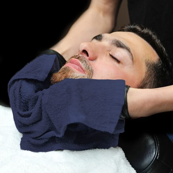 Barber using navy True Color Bath and Hand Towels on customer