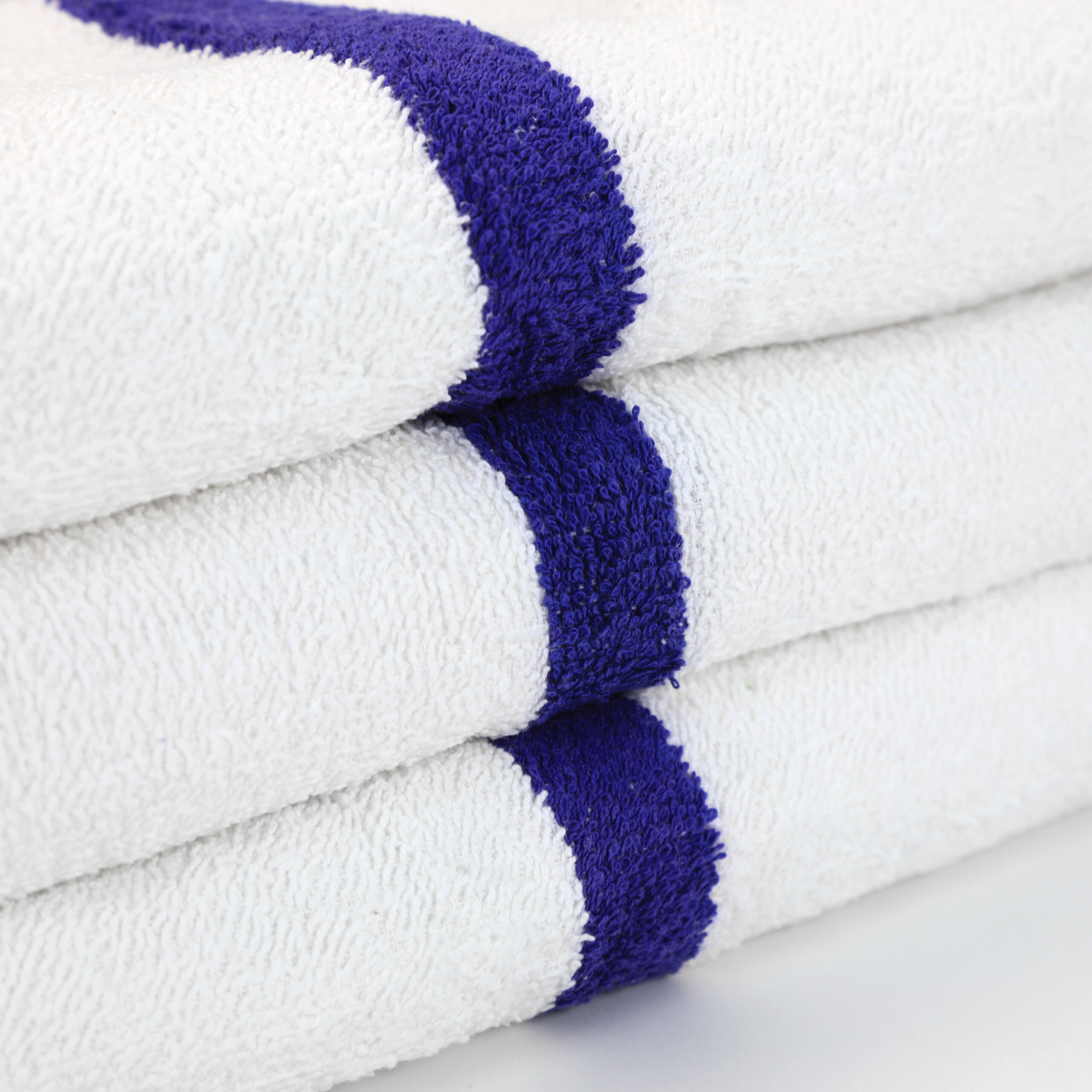 White Gym Towel with Blue Stripe stacked closeup