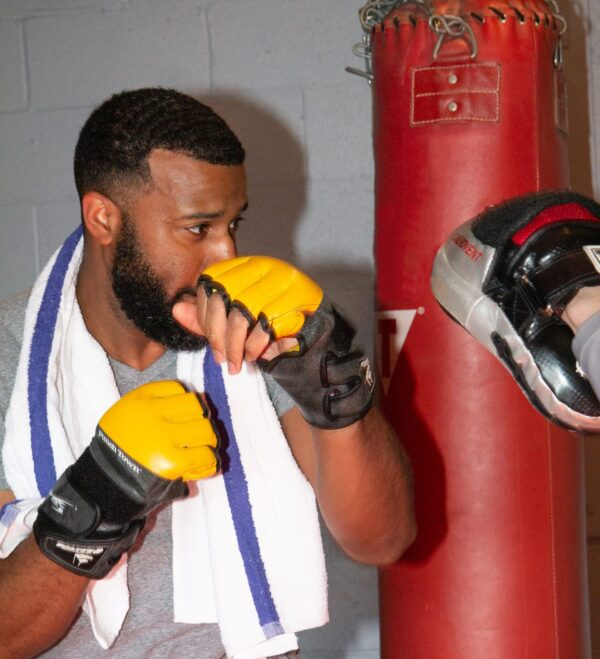 Boxer with Gym Towel with Blue Stripes wrapped around neck