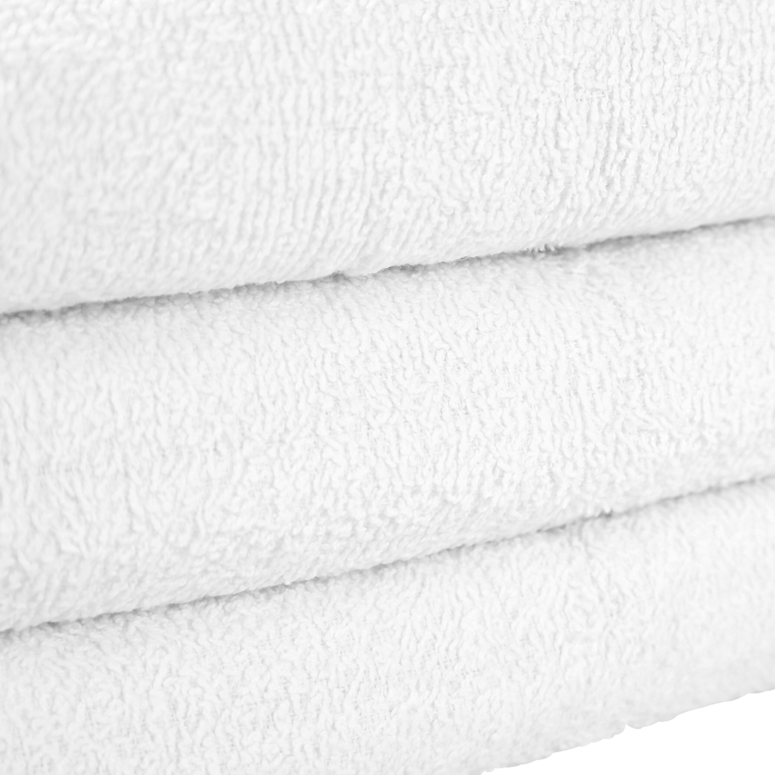 White Bath Towels stacked closeup