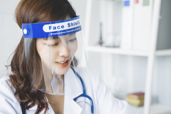 Medical healthcare Asian doctor wearing face shield mask protection