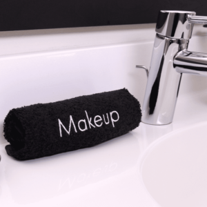 Makeup Towel rolled up on bathroom counter