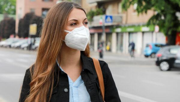 Woman in city street wearing KN95 FFP2 mask