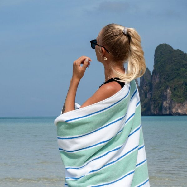 BT-PINSTR-25GB towel wrapped around woman standing by beach