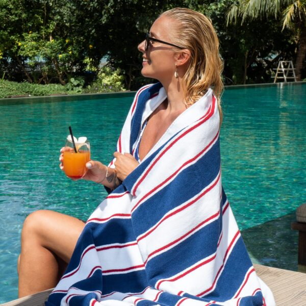 BT-PINSTR-25NR towel wrapped around woman holding a drink by pool side