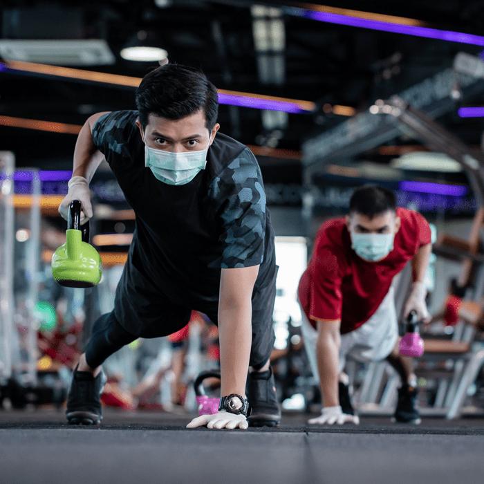 Men wearing PPE masks exercising