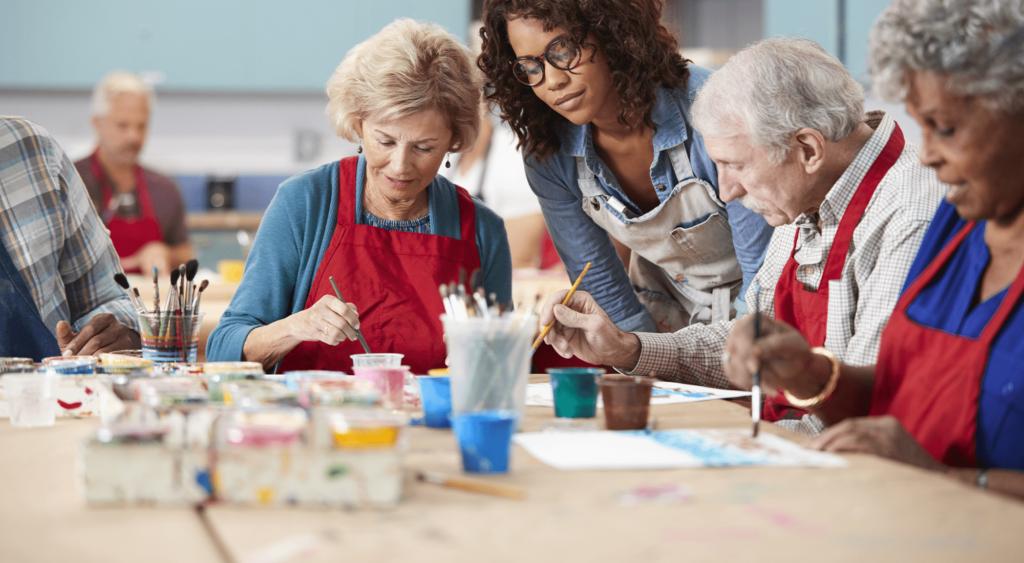 Elder people at an artwork class