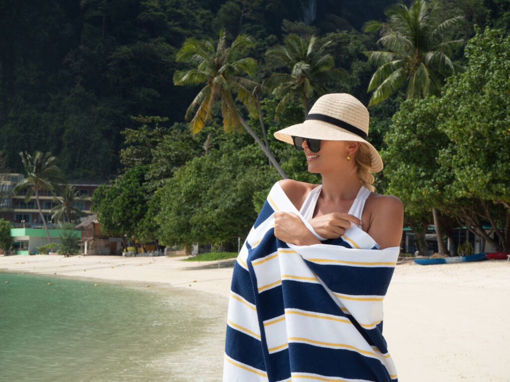 Aston Towel wrapped around woman standing by the beach