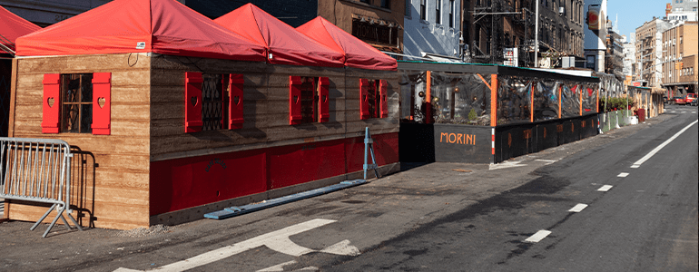 Restaurants expanded onto street causing parking issues