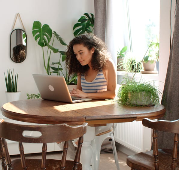 Young woman browsing on computer