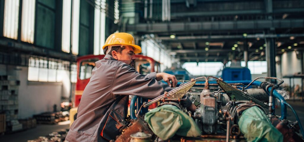 Header Image depicts worker using Janitorial Supplies for MRO